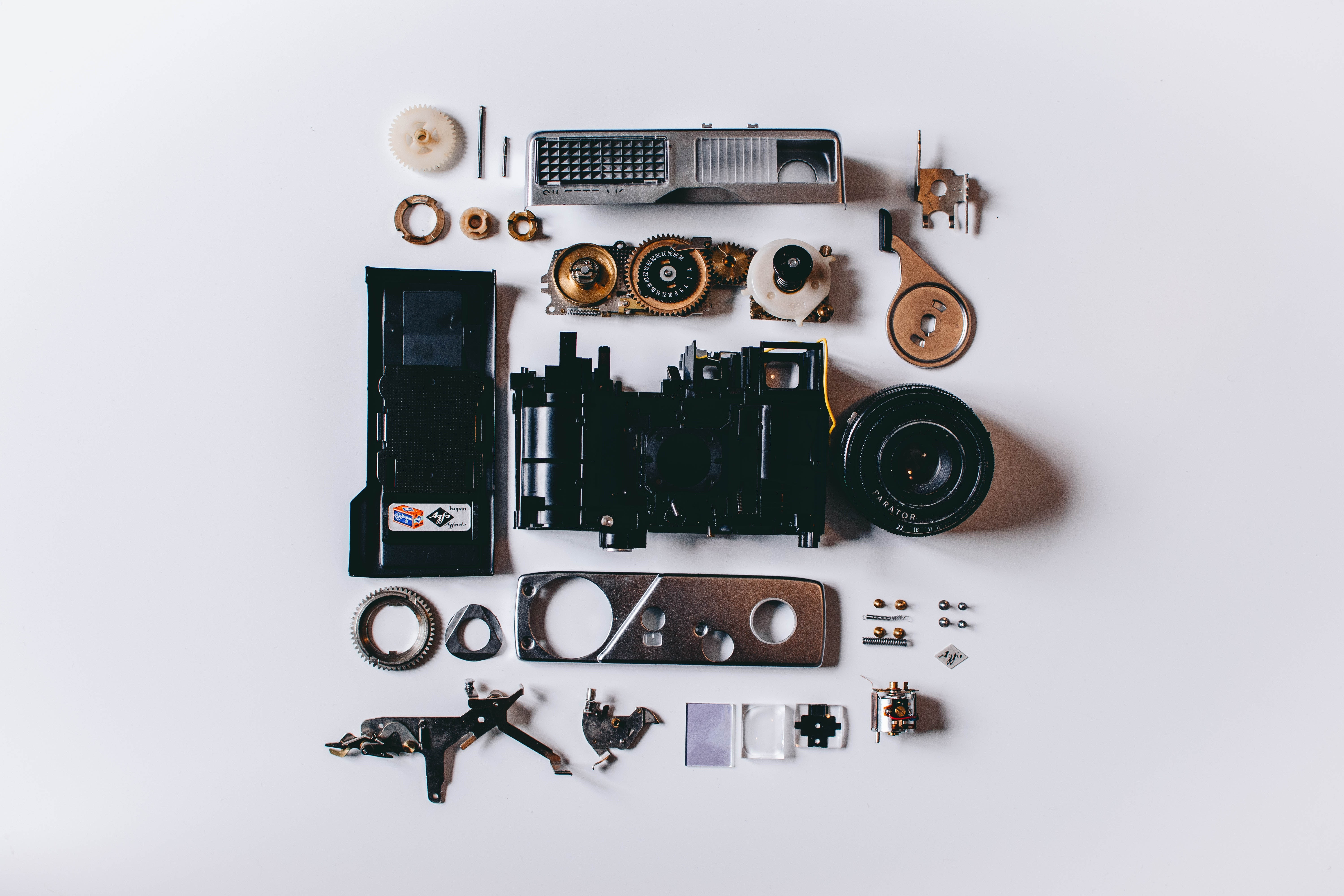flat-lay-photography-of-parts-of-camera-924675